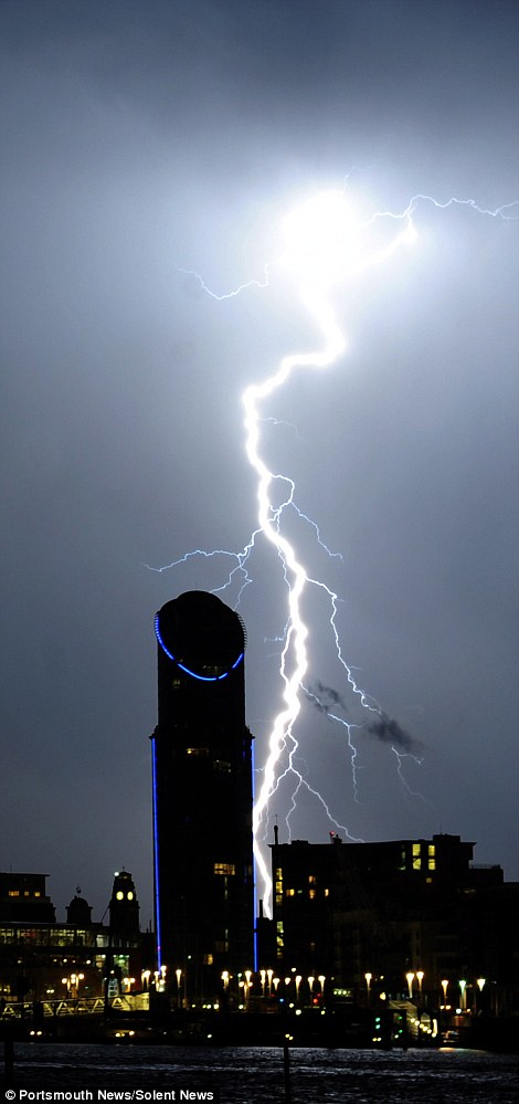 The south coast of England bore the brunt of the thunderstorms with lightning striking Portsmouth's East Side Plaza tower several times during the night