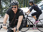EXCLUSIVE: Bono and wife Alison riding bikes near their house in Eze-sur-Mer.  Pictured: Bono Ref: SPL796215  120714   EXCLUSIVE Picture by: Splash News  Splash News and Pictures Los Angeles: 310-821-2666 New York: 212-619-2666 London: 870-934-2666 photodesk@splashnews.com