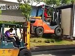 A video of two removal workers has been posted online using a forklift to lift another forklift on to the back of a trailer