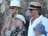 Happy families: The couple looked like they were having a great time during their sunshine break in St Tropez as they asked a passerby to take a holiday snap for them