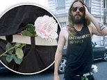 A rose in his BELT? Jared Leto steps out in Paris with a very odd accessory... before getting his hair pulled by a fan