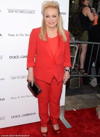 Lady in red! Jacki Weaver dons her favourite colour to ...