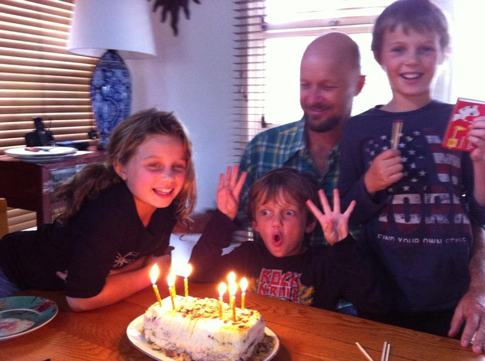 Children: Evie (left), Mo (centre) and Otis (right) Maslin, pictured celebrating a birthday, are among the Australian victims of the disaster, in which a Malaysia Airlines plane was shot down by a missile over Ukraine
