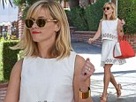 City chic: Reese Witherspoon heads to her office in a gorgeous white two-piece and showcased her tiny pins in a stylish pair of nude coloured sandals