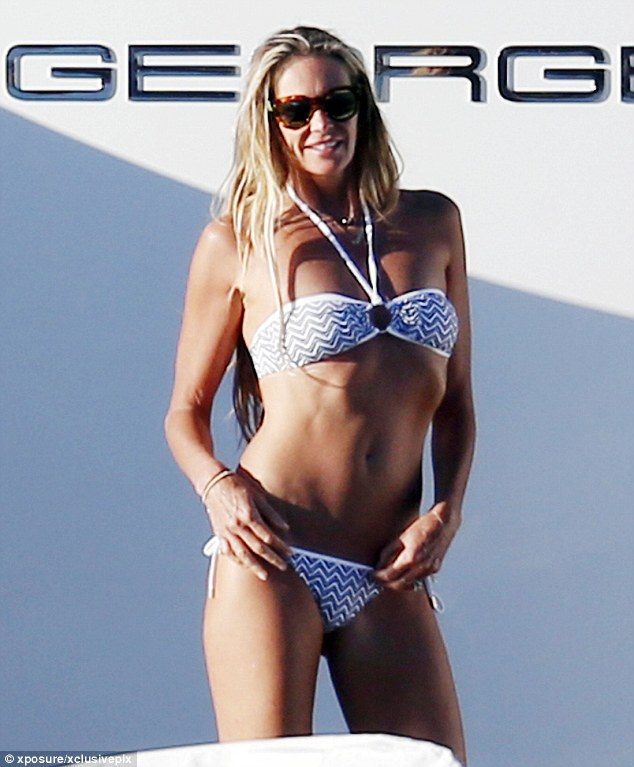 Wow: Elle Macpherson, who is known as The Body, showcased her incredible toned frame while on holiday on a super yacht in Sardinia on Tuesday