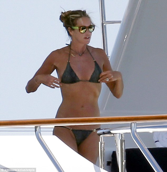 Safety first: The supermodel opted to protect her eyes from the sun with a pair of shades
