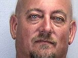 Arrested: Mike Doster was charged with domestic battery after a violent argument with his wife while jet skiing during which she accused him of performing oral sex on another man