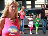 Must be getting serious! Tara Reid grabs ice cream with her DJ boyfriend Erez Eisen and his two daughters