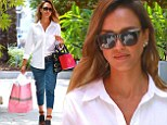 Spicing things up: Jessica Alba made for a stylish boss as she embellished her work outfit with a leopard print belt and funky heels
