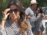 Feeling chummy! Eva Longoria cosies up to actor Terrence Howard in Spain just days before the pair attend Global Gift Gala