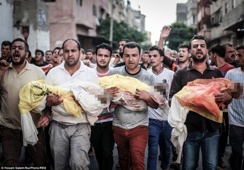 Relatives carry the the bodies of children during the funeral of eight members of the Abu Jarad who were killed overnight in an Israeli strike in Beit Lahia, north of the Gaza strip