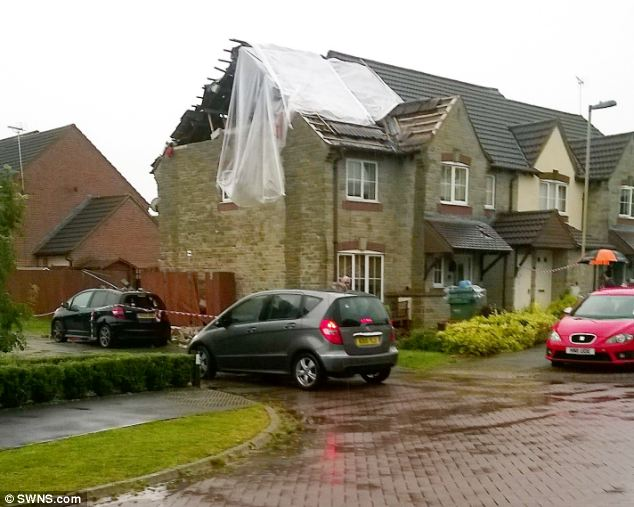 Debris from the damaged roof in Hardwicke, Gloucestershire, crushed a Honda Jazz parked below it