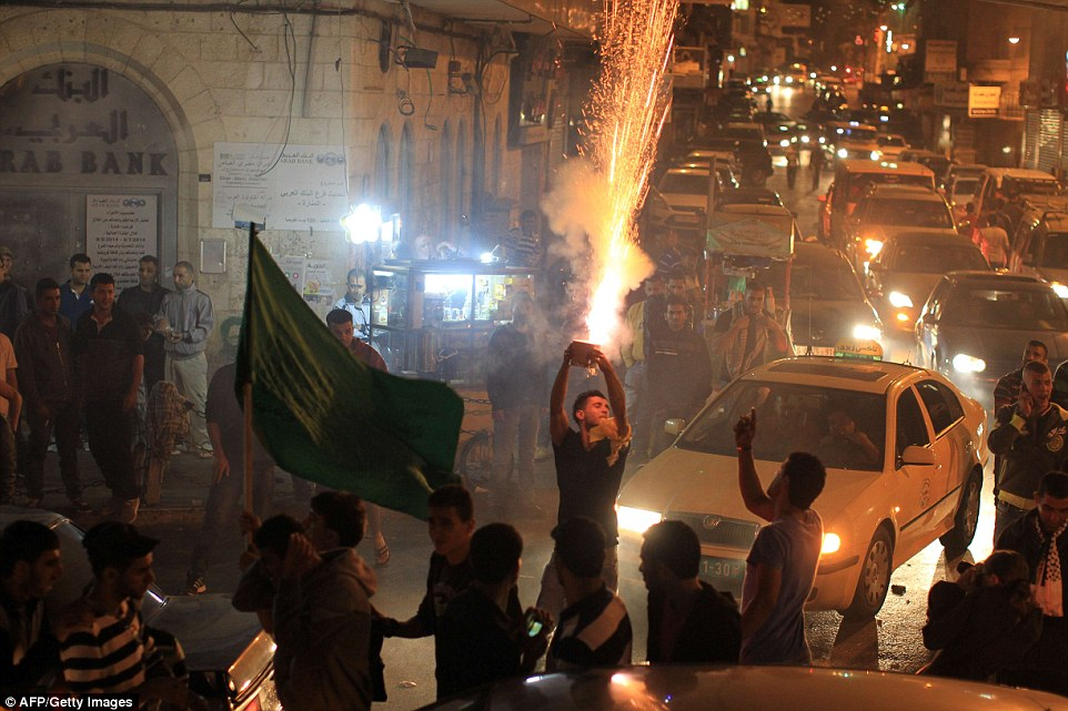 Palestinians launch fireworks during celebrations in the West Bank city of Ramallah, late July 21, 2014,after Hamas' armed wing, the Ezzedine al-Qassam Brigades, said it had captured an Israeli soldier during fighting in the Gaza Strip. A spokeswoman for the Israeli military said they were aware of the claim and were investigating. The Palestinian death toll had risen to 501 on the fifth day of the Israeli ground operation.  AFP PHOTO / ABBAS  MOMANIABBAS MOMANI/AFP/Getty Images