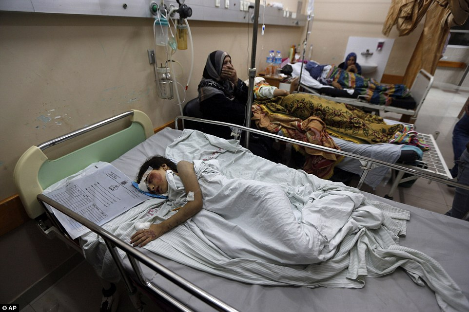 Palestinian Beisan Dhahir, 7, sleeps at Shifa hospital in Gaza City, late Sunday, July 20, 2014. Beisan's home was shelled and collapsed by Israelís military operation in Shijaiyah in the Gaza Strip.  She survived the ordeal with her aunt and uncle. Beisan's mother, father, brother, sister and baby sister all died in the attack.  According to a family relative, the house came crashing down around 11:00 am local time. During a temporary ceasefire, an Associated Press team accompanied Palestinian Red Cross volunteers who managed to speak to the aunt who was trapped under the rubble of her home pleading for help for her husband and Beisan.  By 6pm local time the volunteers were able to free the young girl and her aunt and uncle from the rubble, leaving behind the rest of her family.(AP Photo/Lefteris Pitarakis)