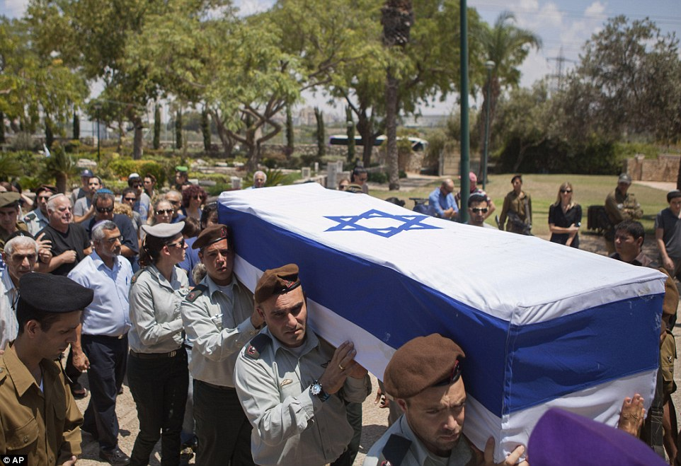Israeli soldiers carry the coffin of Maj. Tzafrir Bar-Or, 32, one of 13 solider's who were killed in several separate incidents in Shijaiya on Sunday, at the military cemetery in Holon, Monday, July 21, 2014. On Sunday, the first major ground battle in two weeks of Israel-Hamas fighting exacted a steep price, killing scores of Palestinians and more than a dozen Israeli soldiers and forcing thousands of terrified Palestinian civilians to flee their devastated Shijaiyah neighborhood, which Israel says is a major source for rocket fire against its civilians. The 13 Israeli soldiers were killed in Shijaiya, in gun battles and rocket attacks. In the deadliest, Gaza fighters detonated a bomb near an armored personnel carrier, killing seven soldiers inside, the army said. In another incident, three soldiers were killed when they became trapped in a burning building, it said. (AP Photo/Dan Balilty)