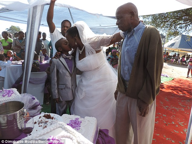 Helen's husband of 30 years, Alfred Shabangu, 66, (right) and their five children, aged between 38 and 28, all attended the ceremony