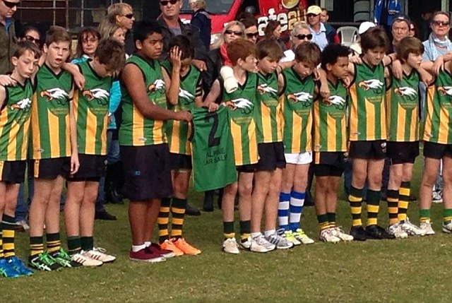 12-year-old Mo Maslin's football team hold a minute's silence for their late friend, who was onboard the fateful MH17 flight with his younger sister, Evie, brother Otis and grandfather Nick Norris