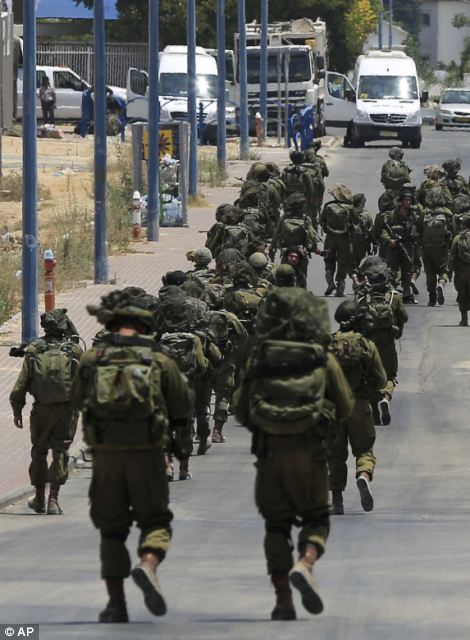 Israeli soldiers patrol the town of Sderot after a group of Hamas militants was detected infiltrating into Israel today
