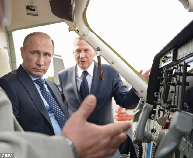 Meanwhile, Putin has been examining samples of aviation equipment at the Production Rocket Space Centre