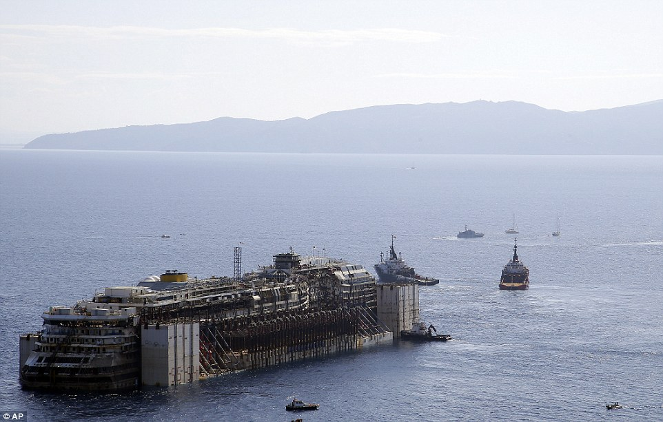 Homeward bound: After more than two years since it slammed into a reef along the coastline of Isola del Giglio the wreck has begun its last journey, to the Italian port of Genoa, where it will be scrapped