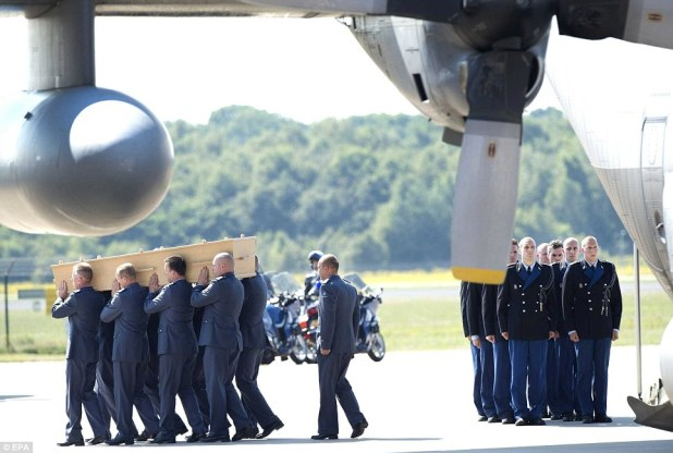 The dignified reception at Eindhoven airport was in stark contrast to the treatment of the victims' remains in eastern Ukraine in the days after the crash