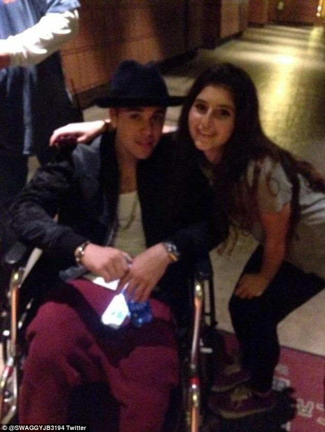 wheelchair knee foldable rocking chair justin bieber takes ride at disneyland | daily mail online