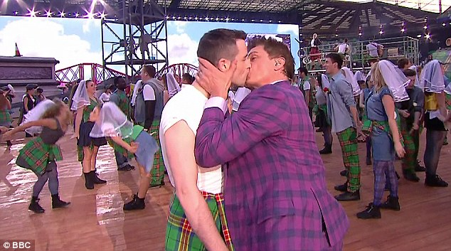 Scottish-American actor John Barrowman, right, kissed one of the performers during the ceremony