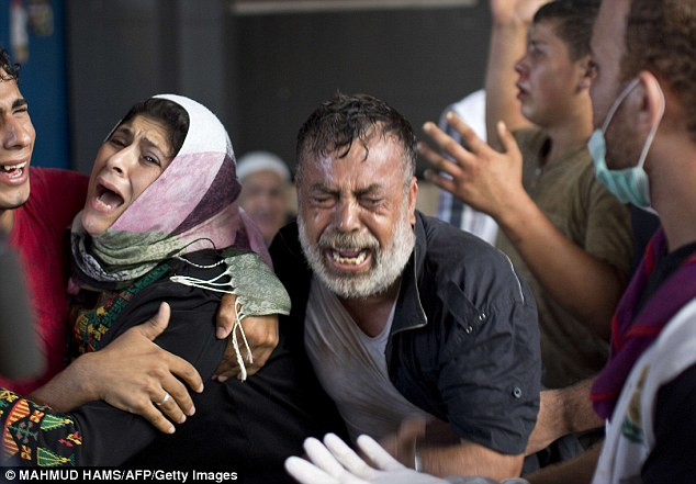 Relatives of the children killed in the attack are disconsolate as they see their loved-ones' bodies laid out