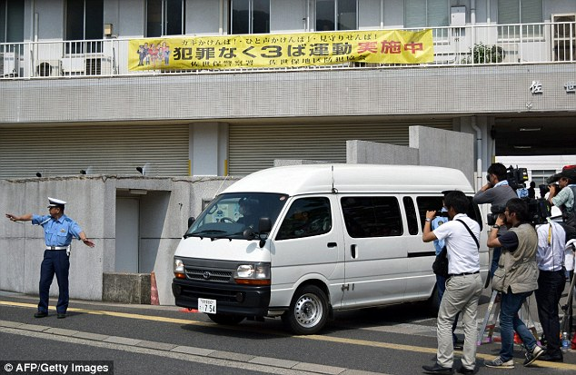 Suspect: A van carrying a 15-year-old schoolgirl - who was arrested on suspicion of killing a school friend at her home - leaves a police station for the prosecutor's office in Sasebo in Nagasaki prefecture
