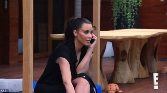 Long distance call: Kim was seen chatting to husband Kanye West on the phone prior to the encounter with her mother