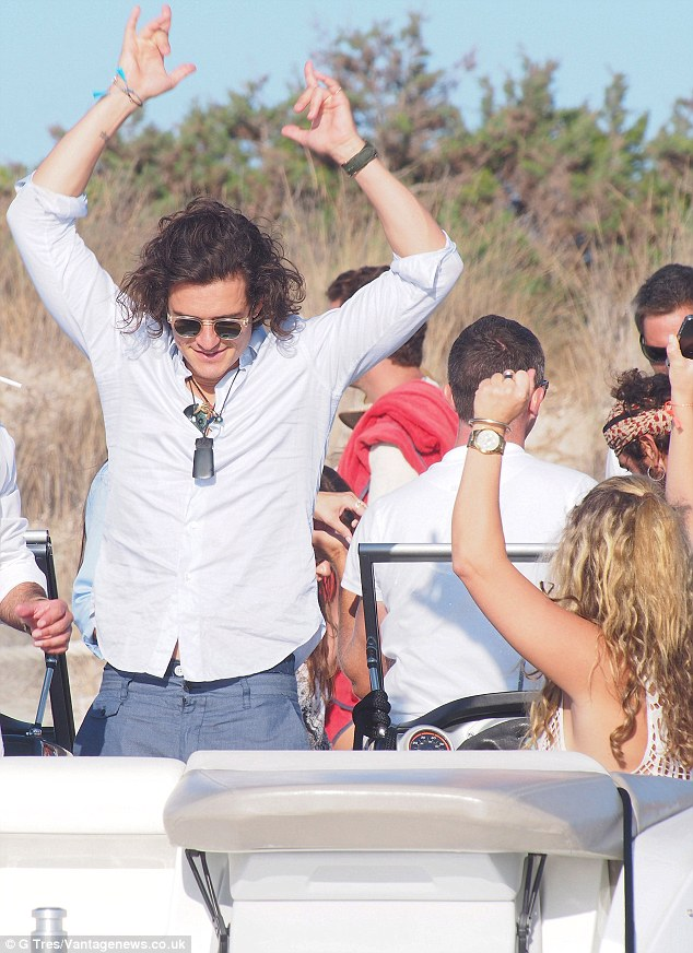 A wild July for the single guy: The Pirates Of The Caribbean actor seen with friends aboard a yacht in Ibiza just hours before the alleged fight
