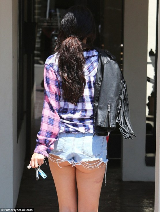 Was that on purpose: The cut-off point of Selena's denim shorts was very high and exposed part of her derriere