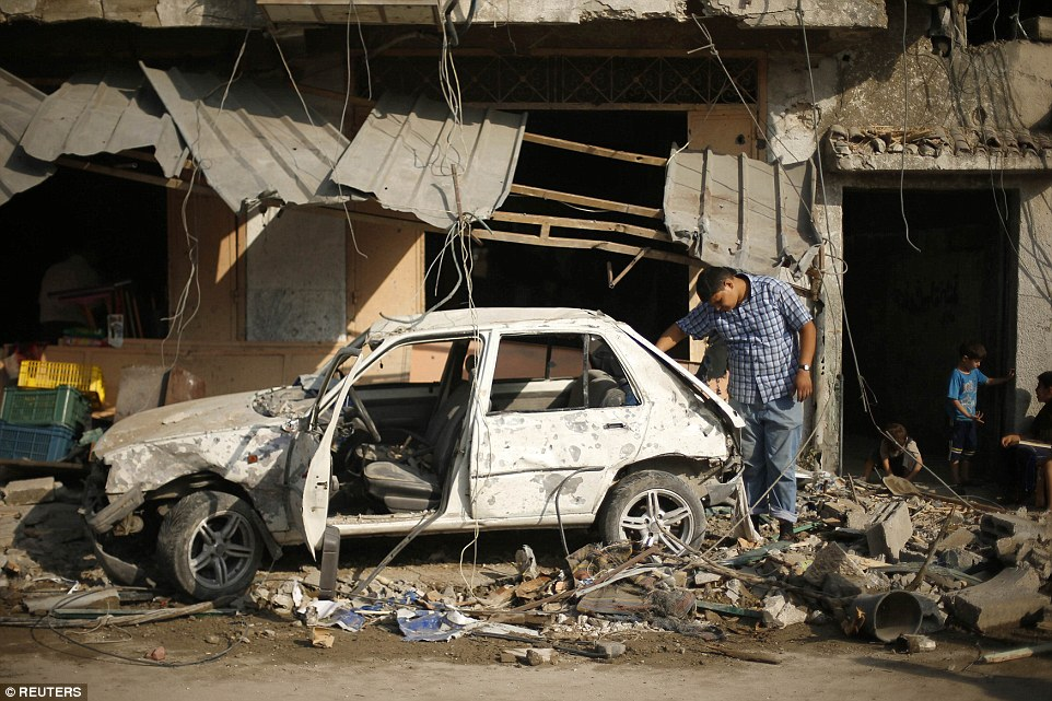 Blame game: A damaged car in Gaza City. The 72-hour truce should have allowed humanitarian aid into Gaza but it broke down in less than 72 minutes