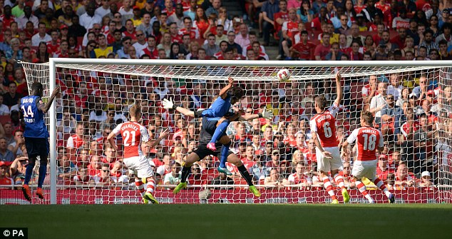 Goalden touch: Radamel Falcao (centre) heads the opening goal of the game for Monaco