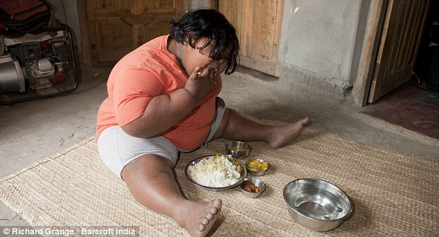 Tucking in: Suman Khatun, who eats 14kgs of rice, 8kgs of potatoes and about 180 bananas a week