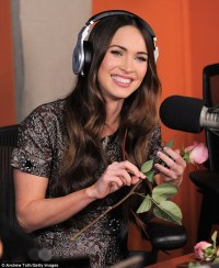 Megan Fox carries rose bouquet while clad in embellished ...