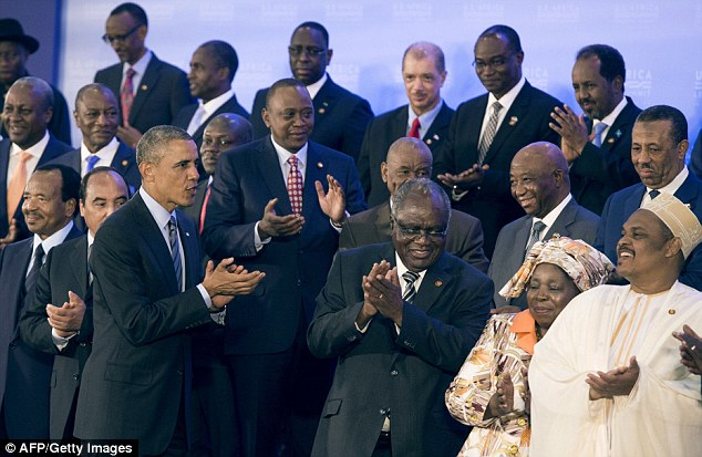 Good job: US President Barack Obama((L)) appauds with African leaders during a group photo at the US - Africa Leaders Summit at the US State Department in Washington DC