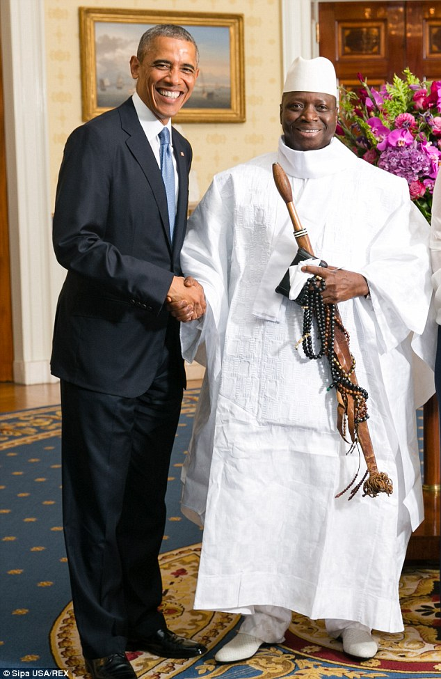 Barack Obama shakes hands with Gambia's Yahya AJJ Jammeh as the presidents pose for an official photo