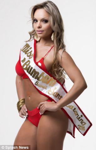Ms Carvalho poses in her sash