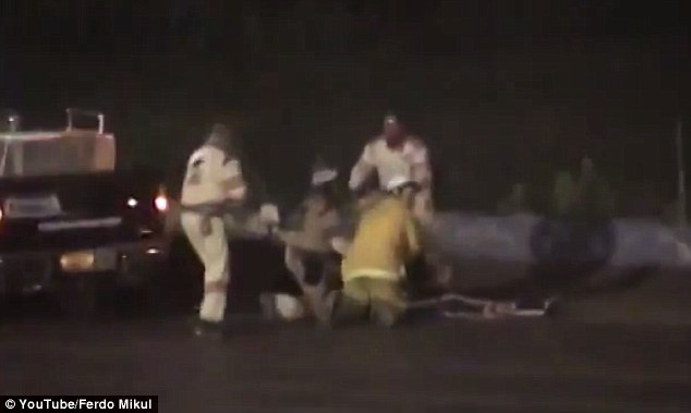 Too late: Paramedics tend to a gravely injured Ward Jr on the track Saturday night