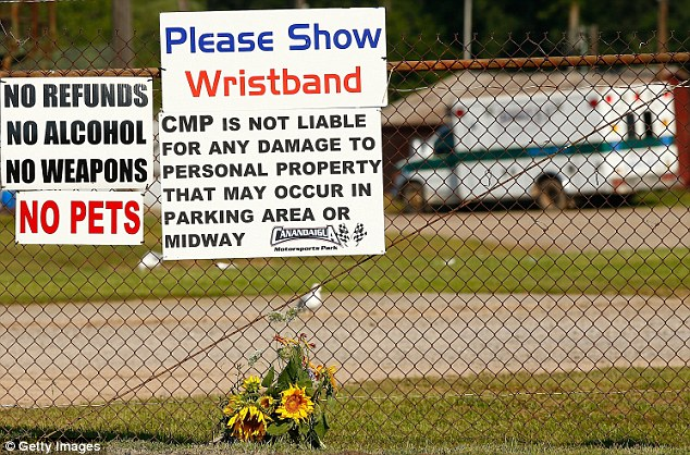Flowers lay next to the front entrance of the Canandaigua Motorsports Park on August 10, the morning after Ward Jr was killed