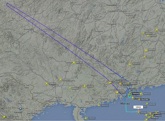 A flight radar map shows the plane's flight path (in dark blue) and how it made a U-turn just 90 minutes after departing Hong Kong International Airport at midnight. The 'disruptive' man was arrested once it re-landed