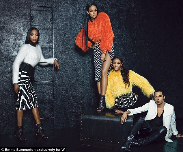 Muses: Olivier, 28, posed alongside the famous ladies, who looked chic in monochrome skirts and brightly-coloured woolen sweaters