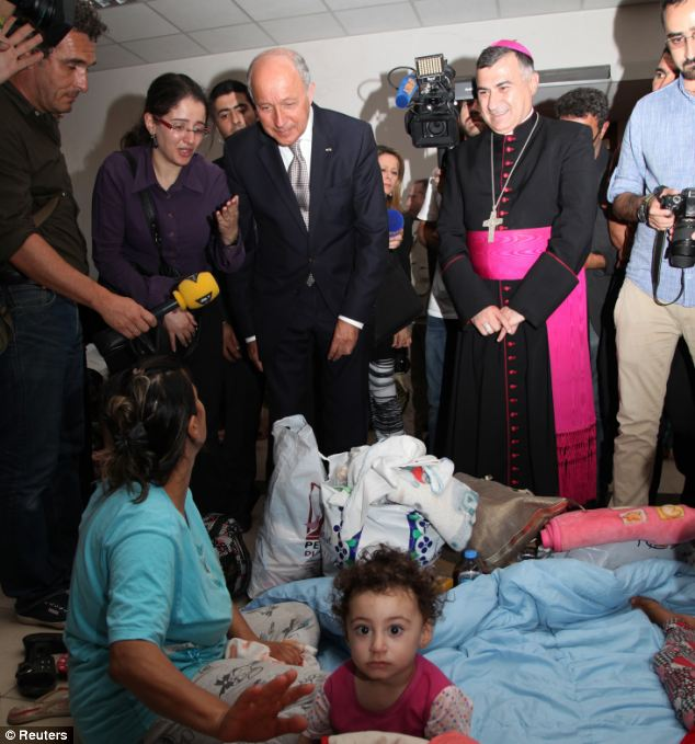 French Foreign Affairs Minister Laurent Fabius (C) visited Iraqi refugees in Nineveh province on Sunday, saying upon his return to France that vacations for certain world leaders should cease while people are dying there