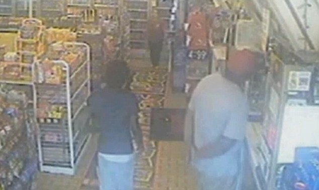 Police released video footage of a 'strong-armed robbery' which took place at a Ferguson store. In this still, the suspect, who police named as Brown, is at the counter