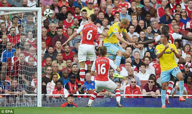 Towering: Brede Hangeland rises above the Arsenal defence to give Palace the lead on 35 minutes