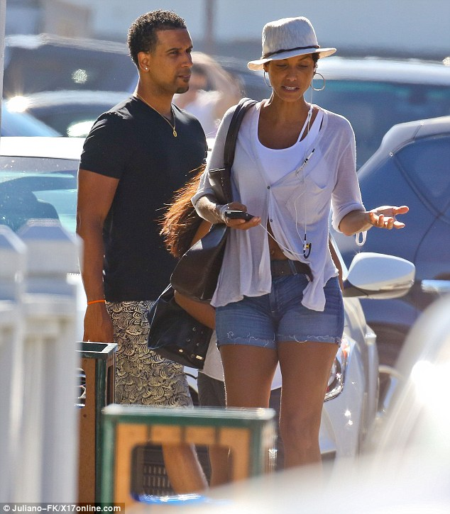 Mystery man: Nicole Murphy was spotted at the beachfront restaurant Moonshadows in Malibu on what appeared to be a date on Saturday