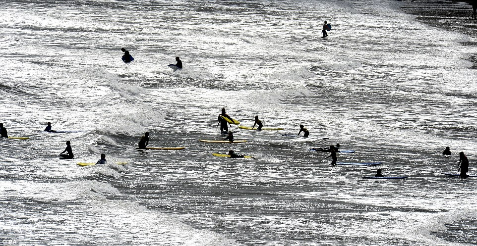 Surfers enjoy the waves at Longsands Beach, Tynemouth, Tyne and Wear as two weeks of wet, windy and cool weather is likely to signal the end of summer