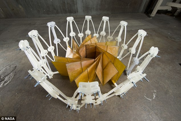 Nasa's solar array has a diameter of 8.9ft (2.7 metres) when folded and 82ft (25 metres) when unfurled. The design, which looks like a flower blooming, was created by Nasa mechanical engineer, Brian Trease
