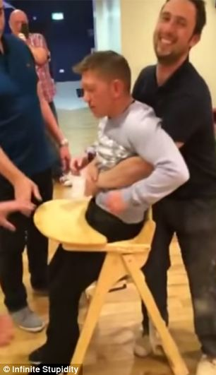 Video captures mans battle with a babys HIGHCHAIR after
